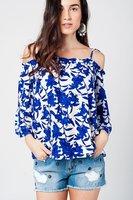 Blauwe top met bloemenprint